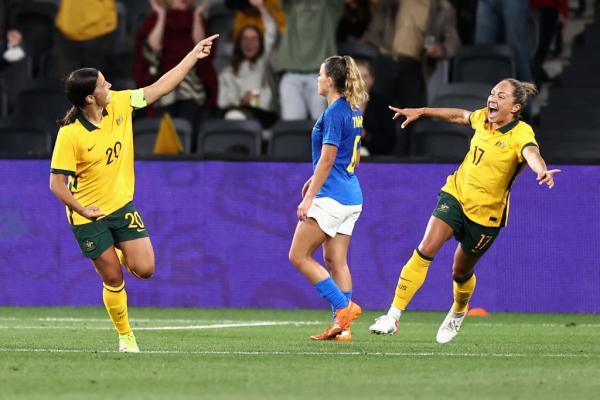 Sam Kerr and Kyah Simon celebrate a goal against Brazil