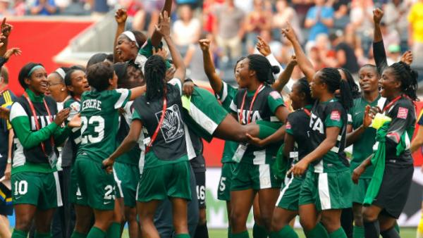 Nigeria's Ngozi Okobi celebrates with teammates after being named player of the match against Sweden.
