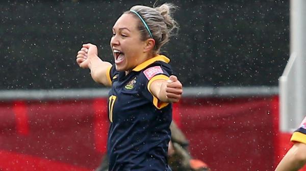 Kyah Simon celebrates her match-winning goal against Brazil.