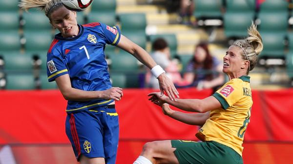 Elise Kellond-Knight competes for a header with Swedish midfielder Lisa Dahlkvist.