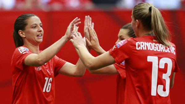 Switzerland players celebrate a goal in their 10-1 win over Ecuador.