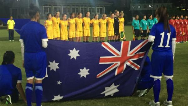 The Mini Matildas sing the national anthem ahead of kick-off against Vietnam.