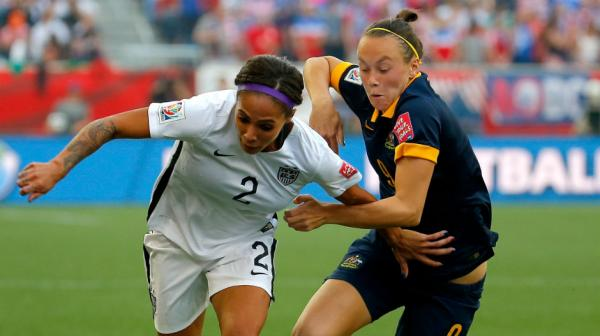 Caitlin Foord jostles for the ball with America's Sydney Leroux.