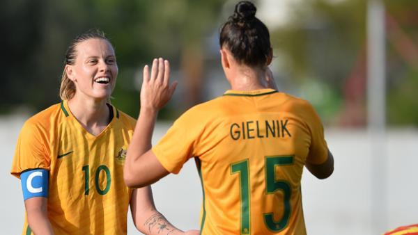 Emily Gielnik and  Emily Van Egmond celebrate a goal in Australia's 2-1 win over China.