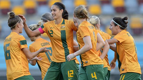 Kate Gill celebrates with teammates after scoring for the Matildas against Brazil in a friendly.