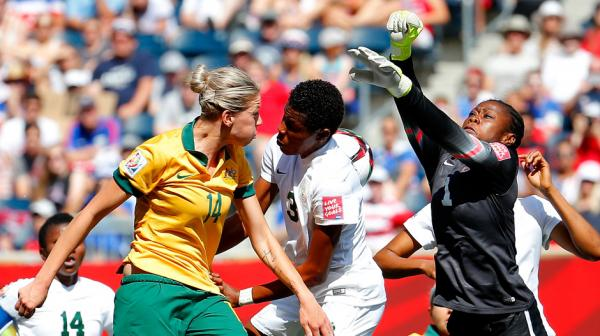 Alanna Kennedy competes for a header in the first half against Nigeria.