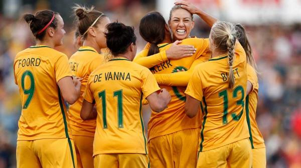 The Westfield Matildas celebrate a goal.