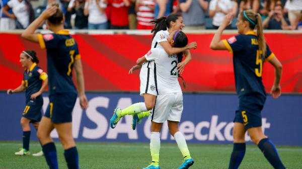 The USA celebrate Christen Press' second-half goal to put their side ahead.