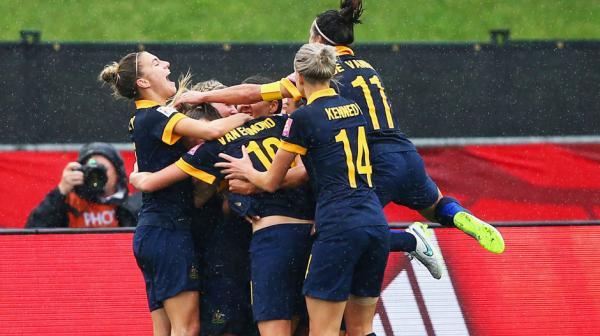 Matildas players celebrate Kyah Simon's goal against Brazil.
